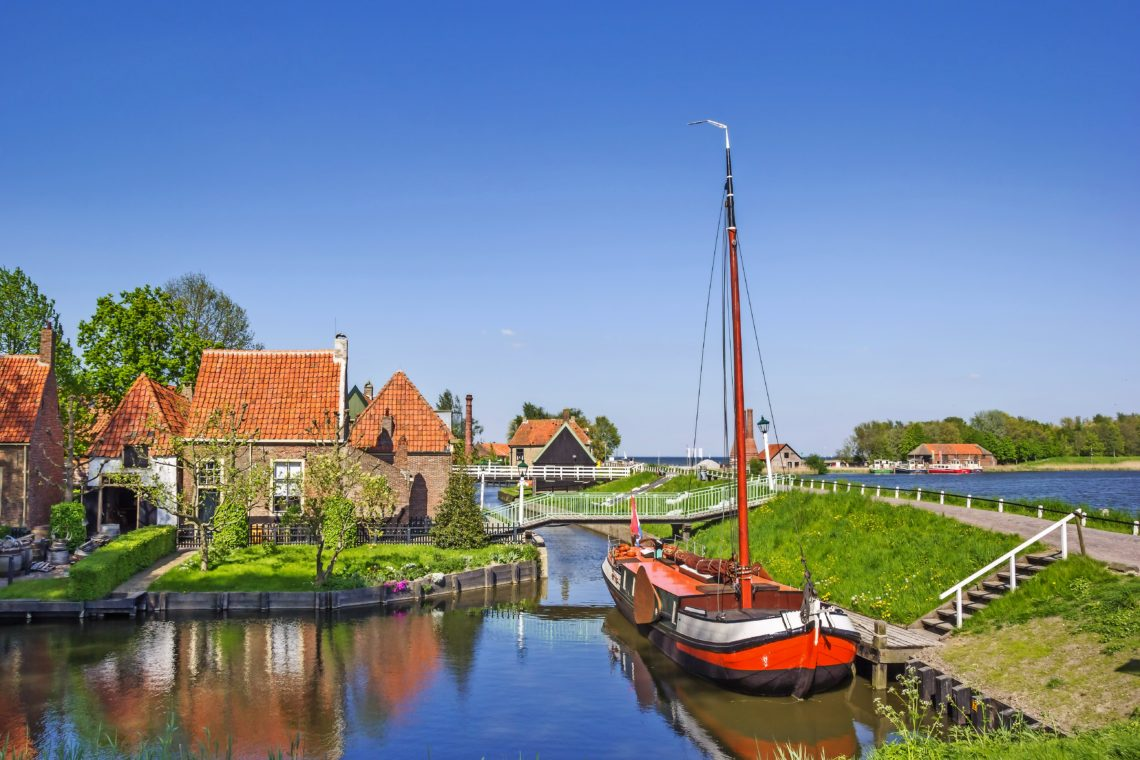 Old sailing ship in a canal in Enkhuizen, Netherlands
